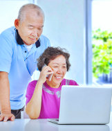 senior couple are having a transaction payment using laptop