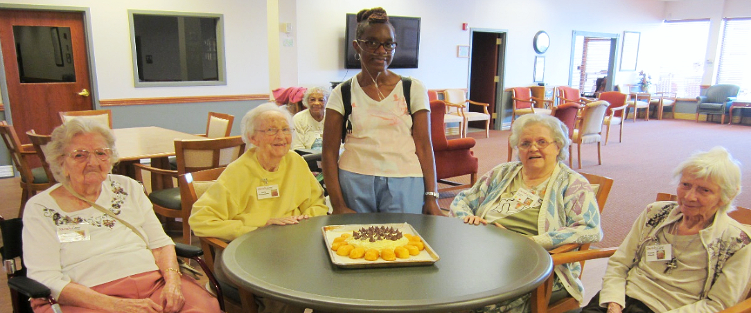 caregiver helping the senior woman to wear a clothes