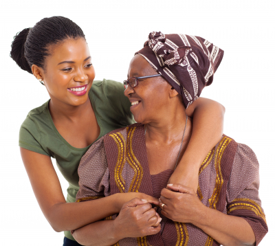 caregiver and senior woman are smiling together while hugging